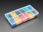 Closed clear box full of short lengths of multi color heat shrink