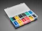 Opened box full of short lengths of multi color heat shrink