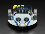Front of robot showing sonar sensor and two LED headlamps.