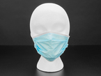 Blue mask shown on a mannequin head