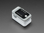 Grey and white pulse oximeter with OLED readout screen on top