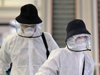 Two people wearing the hat in addition to other PPE gear