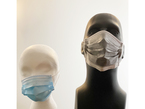 Mask shown side by side on two different mannequin heads