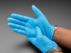 Blue nitrile gloves show being worn
