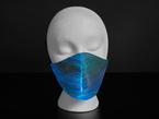 A styrofoam head wearing a black face mask with light blue optic fibers.