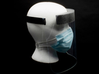 Ear saver in use, displayed on a mannequin head wearing a face shield and mask
