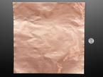 Copper sheet next to quarter