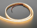 Coiled LED strip lit up warm white