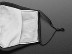 Back of face mask shown with close up of pouch for filter