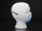 Mannequin shown from the side wearing a mask attached to a black silicone ear saver