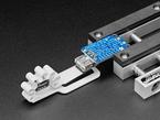 Stickvise Part Lifter holding a USB jack onto a PCB
