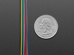 Detail of 10 colored wires next to quarter