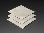 Three pieces of metallic Nylon Fabric Squares with Conductive Adhesive