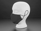 Profile of a mannequin wearing a black fabric mask