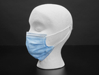 Profile of a mannequin wearing a blue disposable mask