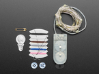 Kit contents showing sewing tools, thread, and LED strip