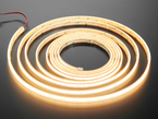 Long Coiled LED strip lit up warm white