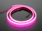 Coiled LED strip lit up pink