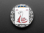 """Top-down shot of round 1.54"""" tricolor e-ink display. On the display is a friendly, white-and-red snake, Blinka the CircuitPython."""
