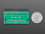 Back of 40-pin FPC to 2x20 socket header adapter PCB next to US quarter.