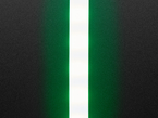 Vertical close-up of LED strip with translucent white sheathing. The LEDs flash green.