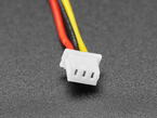 Closeup of 1.25mm pitch 3-pin connector on cable.