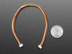 1.25mm pitch 5-pin 20cm long cable above US quarter.