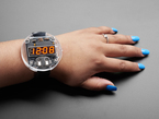 Arm with large round watch with 7 segment display