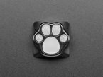 Top-down shot of black and white paw print keycap.