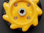 Close-up of L embossed on left mecanum wheel.
