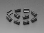Angled shot of 10 black silicone USB A covers.