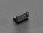 Angled shot of single black silicone USB A cover.