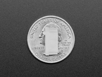 Top view of single translucent HDMI cover atop a US quarter for scale.