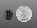 Bottom of silicone RJ-45 cover next to US quarter for scale.