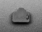 Front view of single black silicone RJ-45 cover.