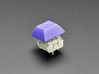 Purple DSA keycap installed on Cherry MX switch