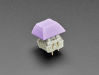 Lavender DSA keycap installed on Cherry MX switch