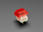 Translucent Red DSA keycap installed on Cherry MX switch