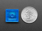 Bottom of DSA BLUE TRANSPAREN color keycap  next to US quarter.
