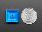 Bottom of DSA DARK BLUE color keycap  next to US quarter.