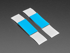 Angled shot of single blue rectangular foam tape.