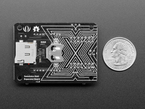 Bottom of expansion board next to US quarter for scale.