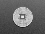 Back of RP2040 chip atop a US quarter for scale.