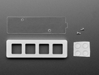 Top view of 4-key aluminum shell, acrylic backplate, rubber bumper feet, and two screws.