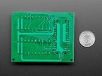 Bottom of Screw Terminal Block Breakout Module Board for Raspberry Pi Pico next to US quarter for scale.