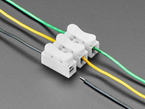 Angled shot of 3 different colored wires plugged into the 3-pin wire joint.