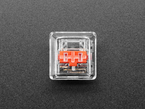 Top shot of single clear keycap installed on Red Kailh Choc key switch