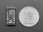 Bottom of Sony Spresense sensor add-on board next to US Quarter for scale.