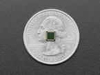 Bottom of LSM9DS0 module atop a US quarter for scale.