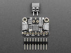 """Top view of MCP9001 breakout above a black 2-pin terminal block and a piece of 0.1"""" male header."""